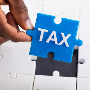 puzzle piece saying TAX